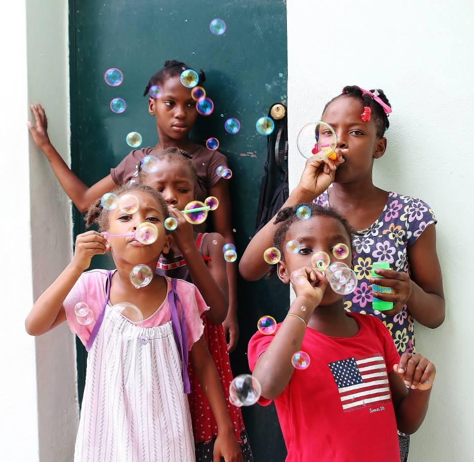 Haiti children blowing bubbles